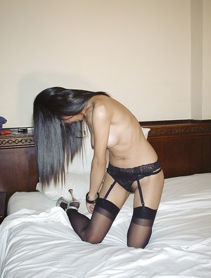 Big tits Asian babe Fon is filmed absolutely naked on her bed