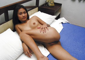 Asian slut Nuanne fingering pussy on bed and waiting for a miracle