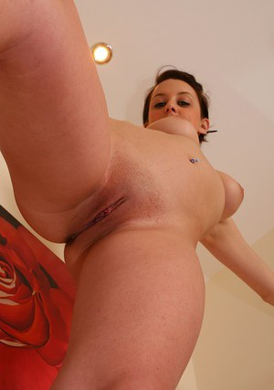 Close up posing scene with an lustful girl Poppy covered in oil