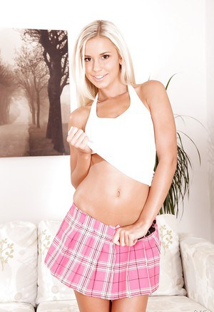 Clothed lady Lola is showing her ass in a fantastic pink skirt