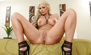 Booty whore Phoenix Marie poses in high heels and shows pussy