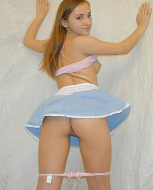 Slender amateur girl Olga is filmed from upskirt in her room