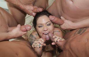 Cute blowbang star Karmen takes cum in mouth and on her face