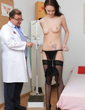 Big tit skinny brunette Belle is at the gyno exam with her pussy