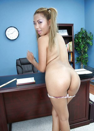 Asian schoolgirl babe Lana undressing her school uniform in a sexy way