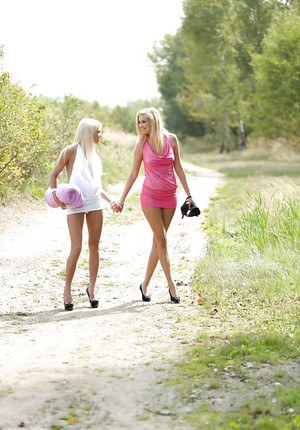 Cute looking lesbian blondies kissing and humping outdoor