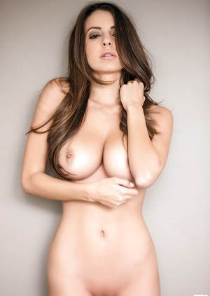 Amazing brunette babe Shelby undressing for a centerfold photo