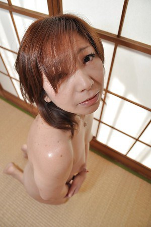 Mature brunette asian Misa showing her nasty pussy and ass too