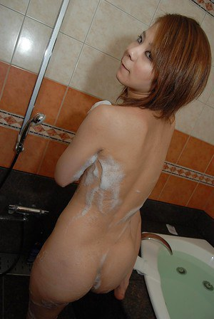 Asian brunette babe with small tits Yoshimi washing her skinny body