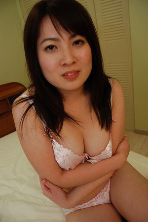 Cute asian brunette babe Momo showing her titties and pussy