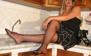 Blonde girl with cute boobs Marlene is a pantyhose model