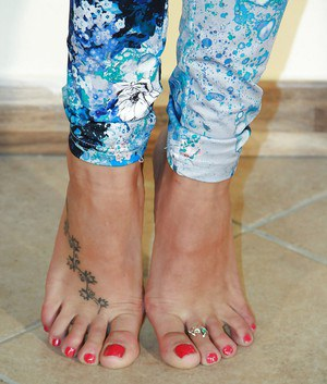 Valeria has a very cute tattoo on her foot that you should check out