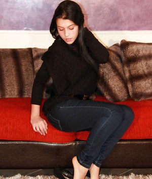Babe in jeans Petra likes to play with her feet and show her body