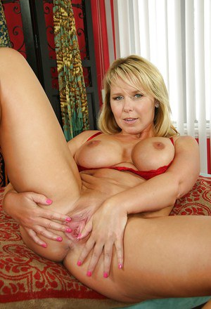 Big tits milf is demonstrating tremendous ass and pussy in red lingerie