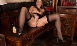 Stockings model Karon Ross is revealing her tight pussy and asshole