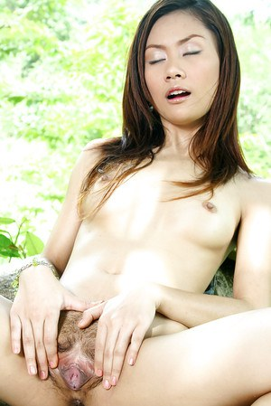 The more you look at this hairy Asian whore outdoors the more you want