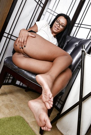 Asian babe in sexy glasses Harley Dean is spreading legs in close up