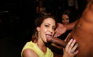Clothed chicks are being entertained by an muscular black stripper