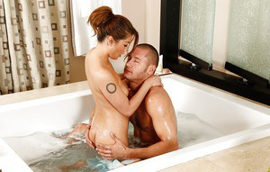 Oiled Asian Charmane Star is doing an awesome blowjob to her man