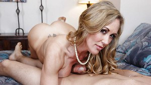 Mature mom Brandi Love is doing an amazing blowjob to a younger guy