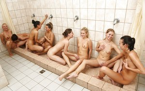 Cute Nessy and her lesbian friends masturbating in the bathroom