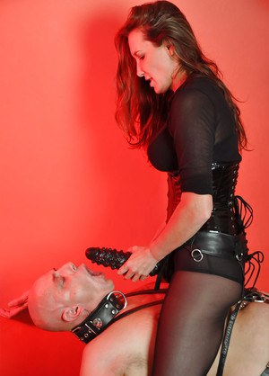Helga dominating over her husband and using a strapon for fun