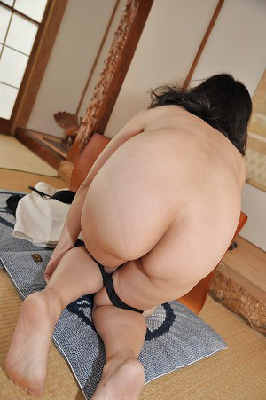 Miyoko Tanigawa is featured in a hot undressing scene in her living room