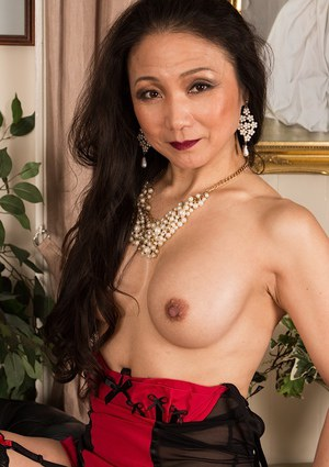 Clothed beauty Aya May is revealing her perfect mature body