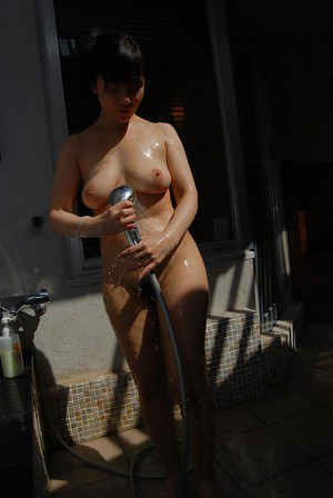 Oiled Asian babe Mayumi Takano is showing her big natural titties