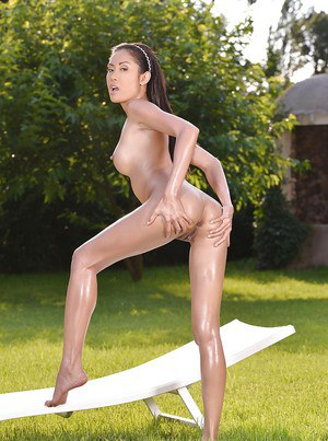 Outdoor posing action from an oiled Asian babe with tiny tits Danika