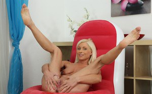 European blondie Vanessa Hell is teasing her pussy and pissing on a chair
