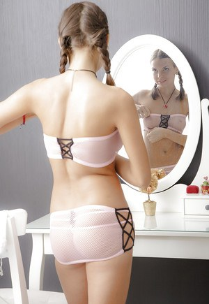 Slender teen with pigtails Carre shows off in a sweet lingerie