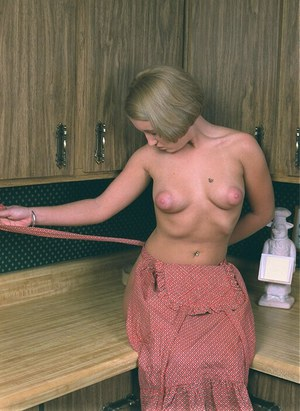 Undressing babe Cricket caught on camera while cooking in her kitchen