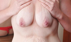 Amateur fatty Margot demonstrates her nasty saggy tits in close up
