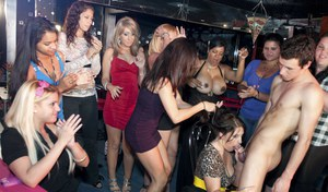 Clothed ladies receive cum on their faces and big tits while partying