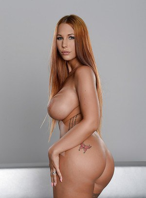 Big tits babe Kyra Hot shows off her big tits in a white skirt
