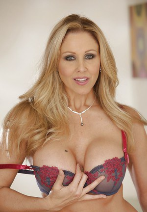 Julia Ann demonstrates her milf pussy in sexy panties and without them