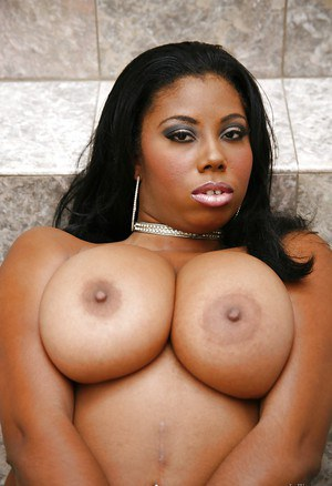 Ebony milf Candace Von reveals her big natural tits in high heels