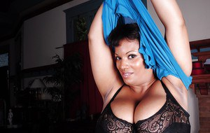 Undressing session features Ebony fatty Betty showing her mature big tits