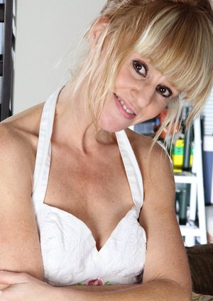 Mature girl Josie spreads her legs and shows shaved pussy in close up