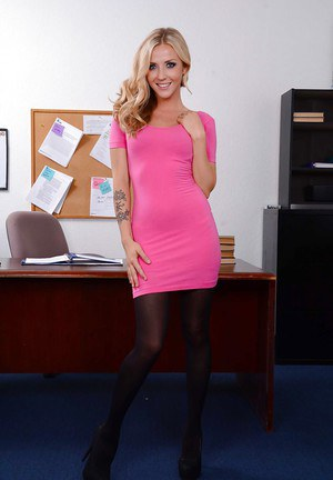 Office blonde babe Karla Kush in sexy black stockings and pink skirt