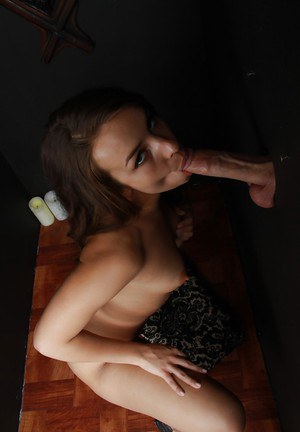 Brunette cutie Sophie Sutra dose blowjob to a dick from gloryhole