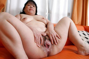 Hairy pussy and fatty ass of a beautiful Asian Eiko Imamiya shown in close up