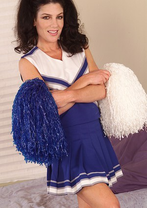 Milf babe Anna shows off in her sexy cheerleader uniform and socks