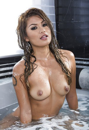 Asian pornstar Charmane Star takes a hot bath and washes her pussy
