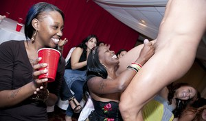 Ebony cuties party hard and enjoy a stripper dance while in clothes
