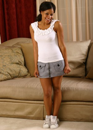 Ebony teen Sandy takes part in an amateur posing scene while in lingerie