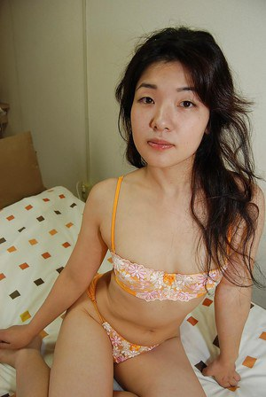 Milf Asian Yuko Goto shows off her tiny tits in a sexy lingerie