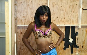 Ebony babe shows off her teen ass and titties in tight shorts
