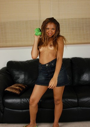 Ebony teen babe Rochelle takes part in an amateur undressing scene